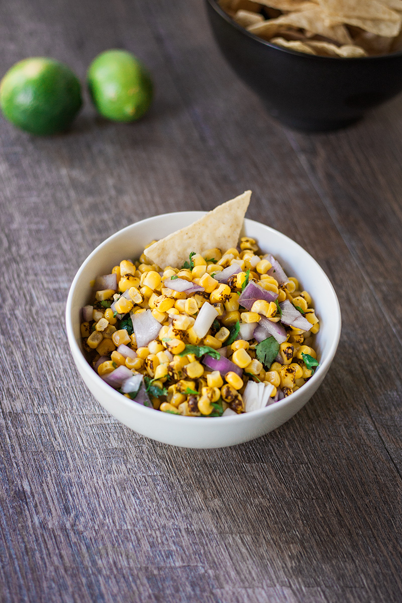 Roasted corn salsa! This crowd-pleasing only take a few minutes to make and is sure to be a huge hit at your next potluck or BBQ! #salsa #homemade #easy #bearplate