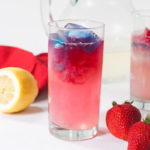 Red, white, and blue Fourth of July ginger lemonade in a glass.