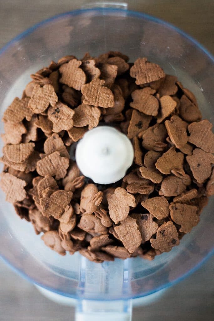 Chocolate graham cracker cookies in a food processor.