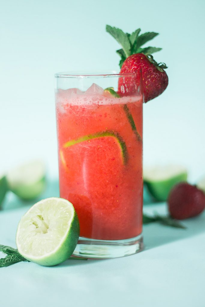 A tall glass of strawberry limeade