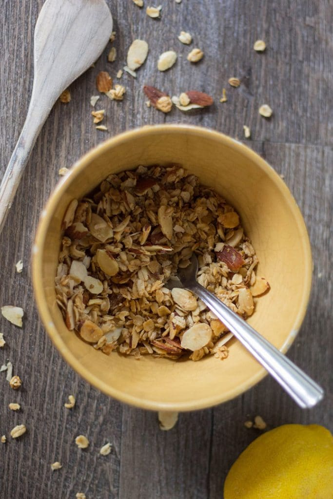 Lemon almond granola in a yellow bowl.