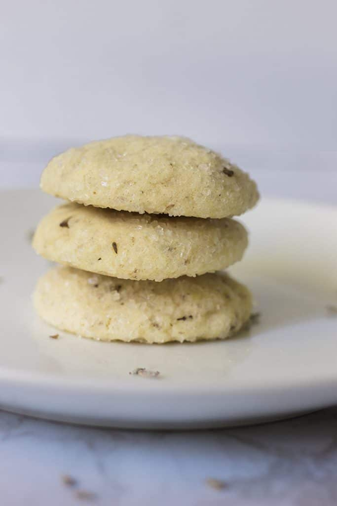 A stack of Vegan Lemon And Lavender Sugar Cookies on a plate.